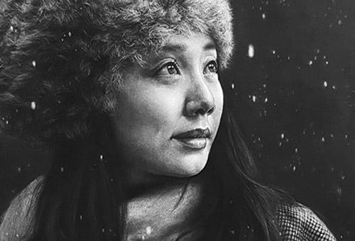 Wing - hyper-realistic portrait of a beautiful asian girl in the snow. Charcoal drawing.